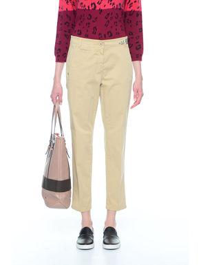 Pantaloni con borchie piatte