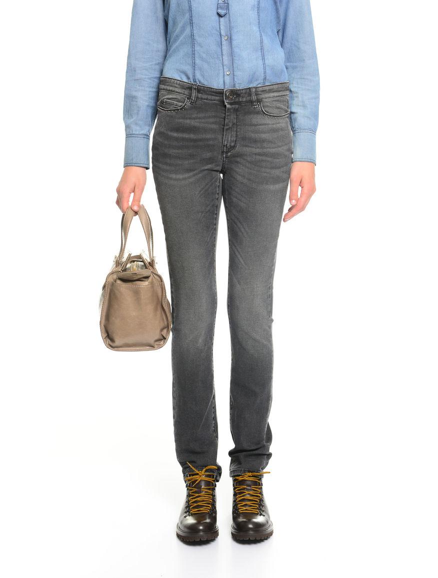 Pantaloni in denim con borchie