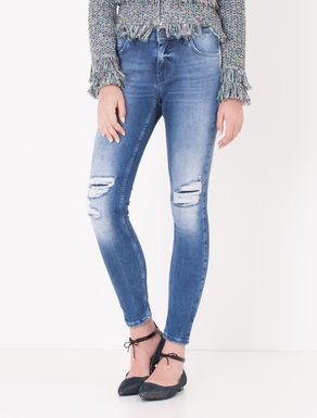 Jeans skinny con strappi e toppe