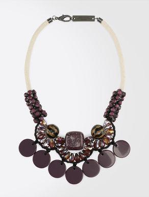 Designer necklace featuring maxi elements