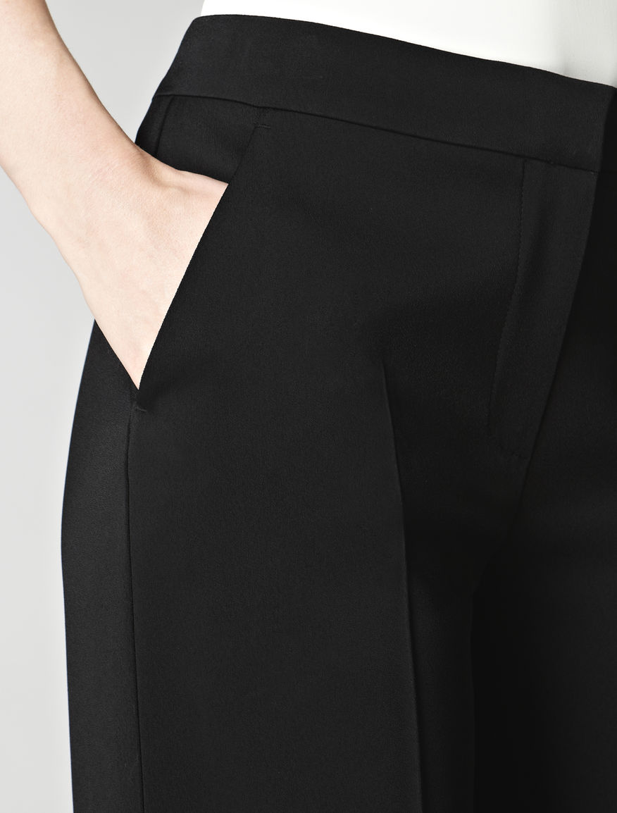 Black trousers with flared silhouette