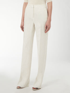 Loose-fitting pin-stripe trousers