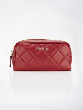 Leather matelass_ beauty case