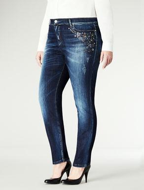 Jeans attillati con dettagli gioiello