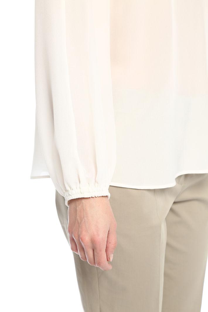 Blusa in seta con cut-out Fashion Market