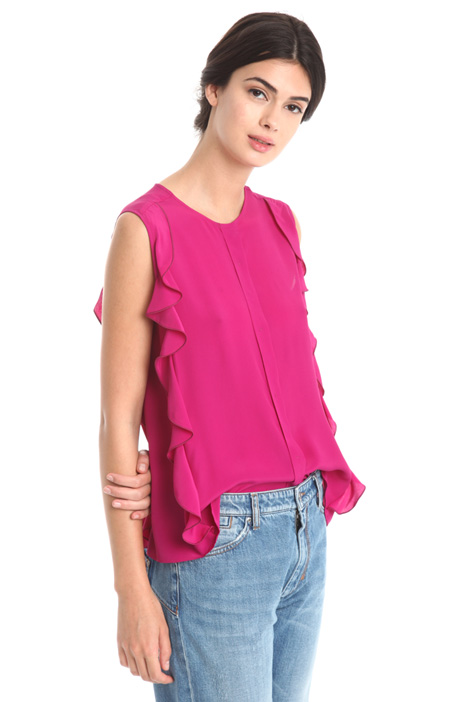 Sleeveless top with ruffles  Intrend