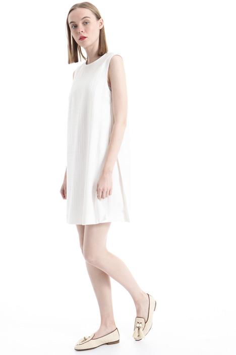 Dress in matelassé fabric Diffusione Tessile