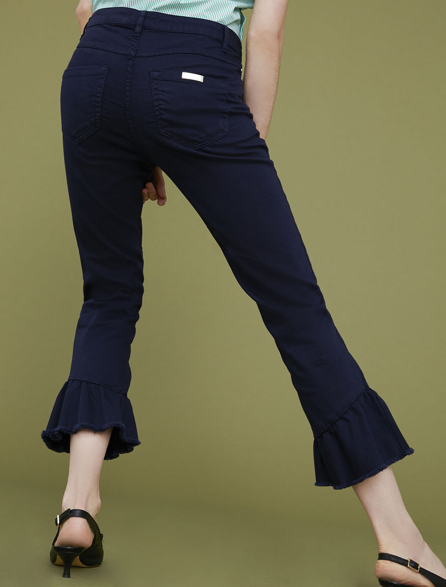 Trousers with flounces