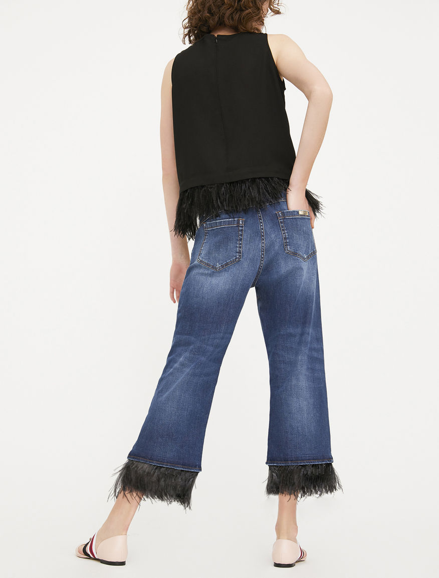 Jeans with feathers