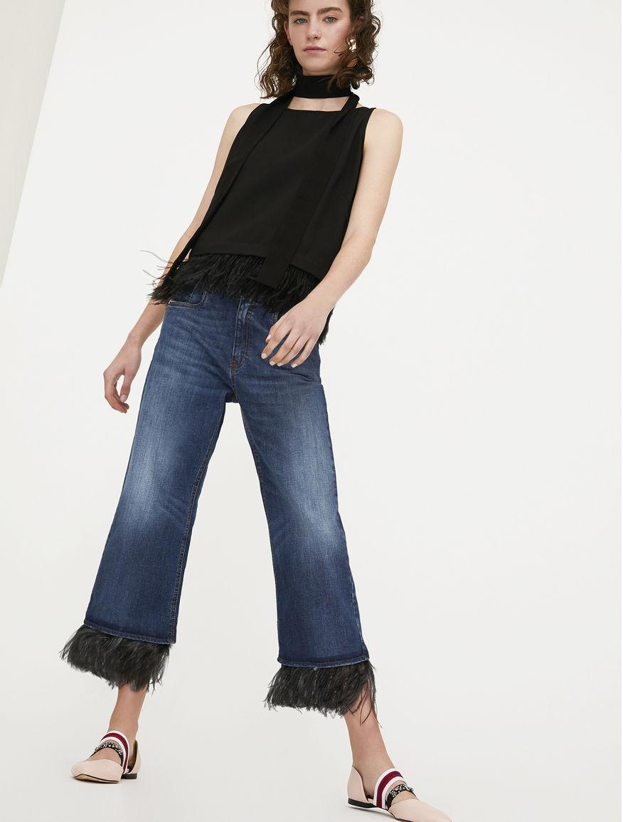 Jeans con piume