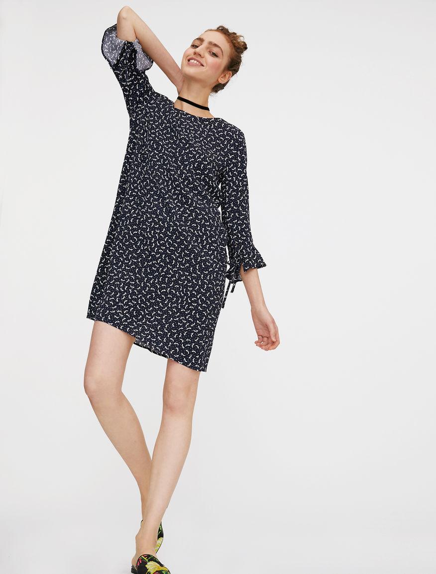 Dress with flounces