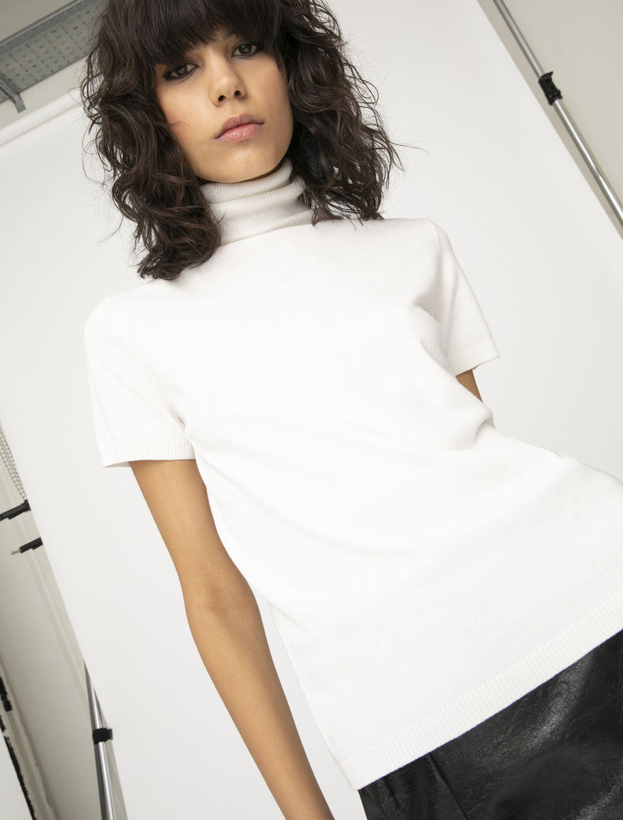 Semi-fitted polo neck jumper
