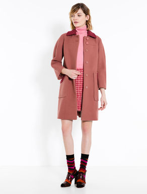 Coat with contrasting inserts