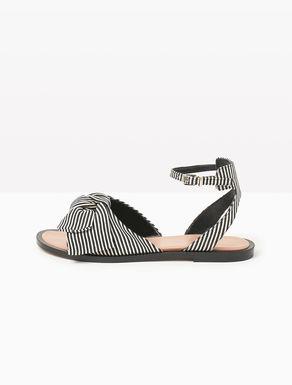 Sandalias planas de tejido con lazo