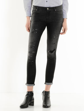 Skinny black jeans with rips
