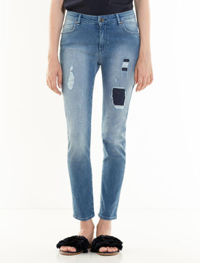 Skinny jeans with rips and patches