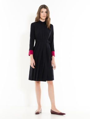 Dress with asymmetrical pleats