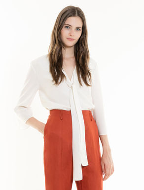 Muslin blouse with tie neck