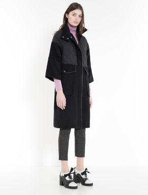 Drap and technical-fabric coat