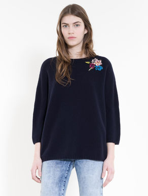 Sweater with floral accents