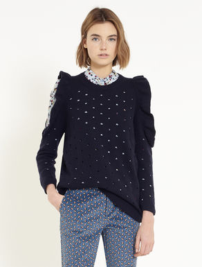 Sweater with eyelets and flounce