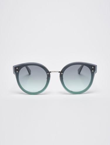 Glittery sunglasses with overlays