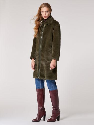 Manteau réversible en peluche