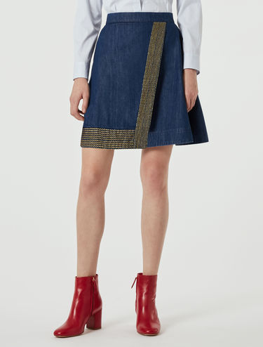 Denim skirt with lamé embroidery