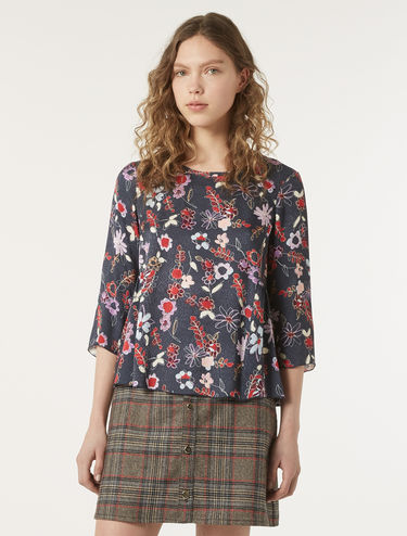 Flowing blouse with flounces