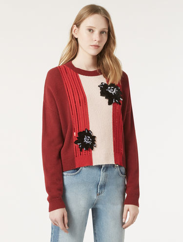 Sweater with floral appliqués
