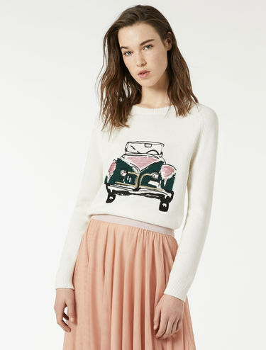 Sweater with inlays and embroideries