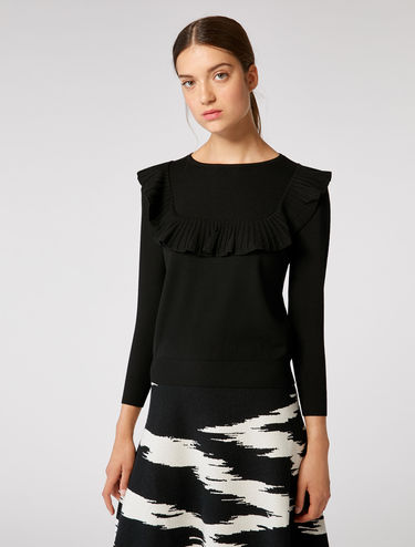 Stretch sweater with flounce