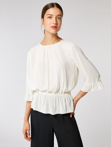 Blouse en georgette à volants