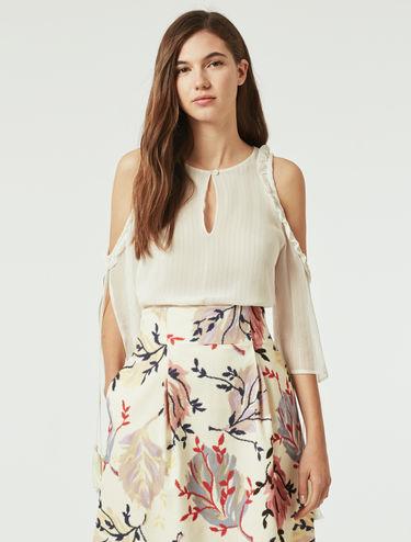 Blusa in seta lamé