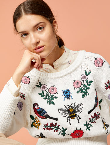 Sweater with embroidered patches