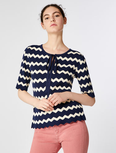 Chevron jersey top with fabric sleeves