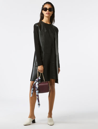 Leather and knit longline coat