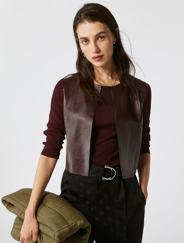 Cropped leather and knit jacket