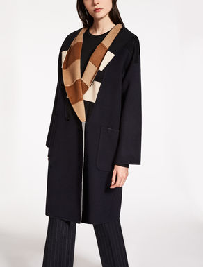 Reversible wool and angora coat