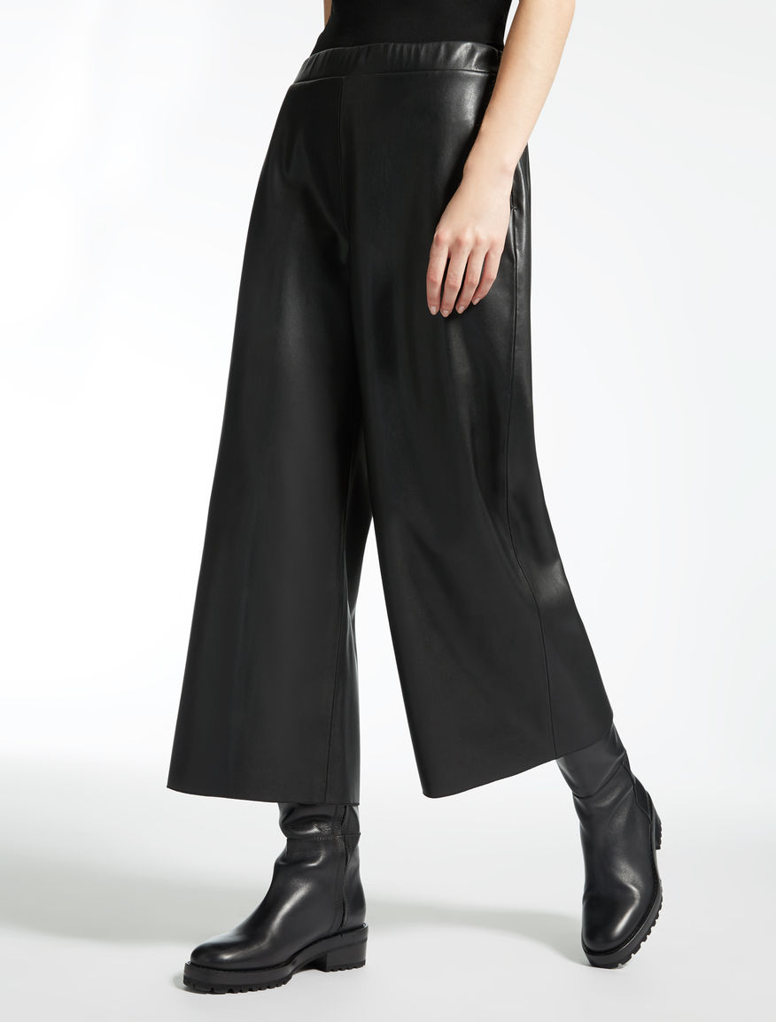 Trousers in coated fabric