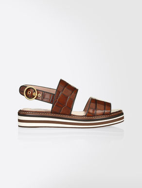 Sandals in crocodile-print leather