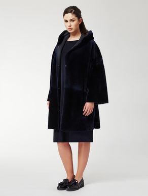 Reversible sheepskin coat