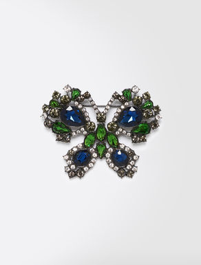 Metal brooch with rhinestones
