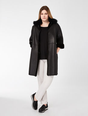Reversible sheepskin coat