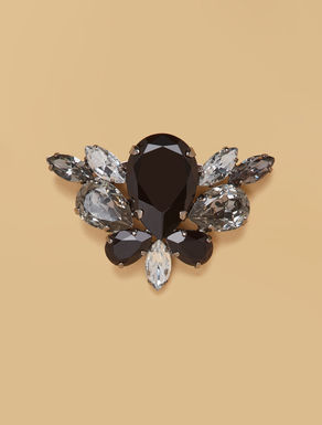 Metal brooch with gems