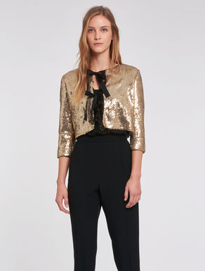 Sequinned jacket with bows