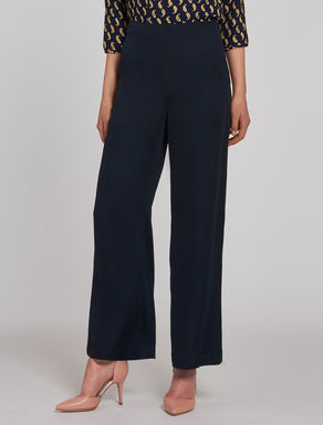 Trousers in fluid fabric