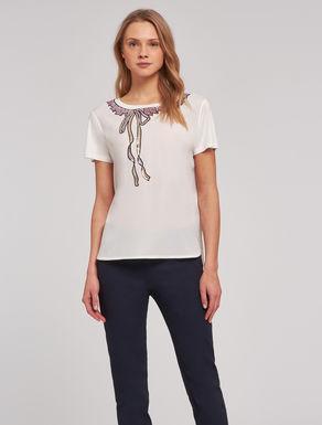 T-shirt fluida con paillettes