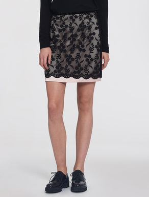 Miniskirt with embroidered lining