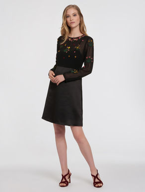 Dress with floral appliqués